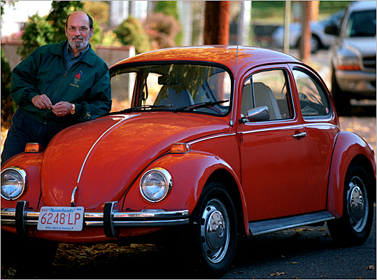 A 1973 Volkswagen Beetle with its owner