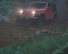 JEEP driving through muddy forest road